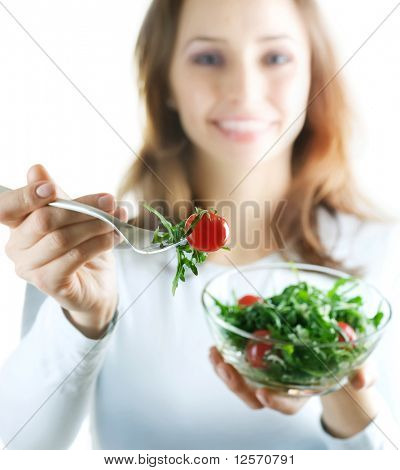 Healthy Eating Concept.Happy Young Woman eating vegetable salad