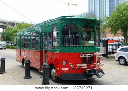 NASHVILLE,TN,USA - SEP 27: Grayline Tour Bus the riverfront of Cumberland River on Sep. 27, 2015 in downtown Nashville, Tennessee, USA