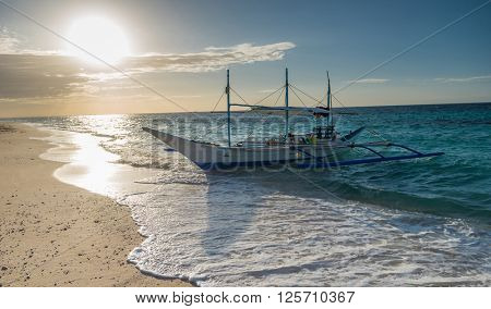 Tropical background sunset view from Boracay island at Puka beach with traditional Philippines boat, blue sky and turquoise sea water, Travel Vacation at Philippines,
