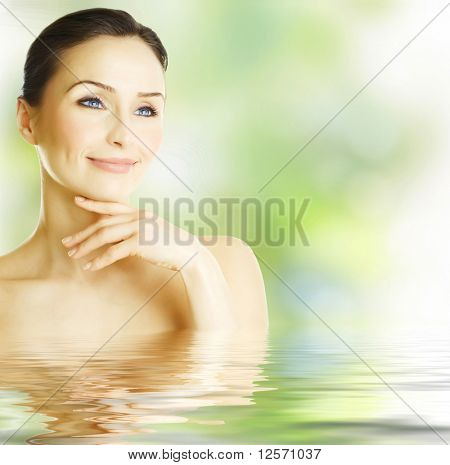 Beautiful Woman over spring background