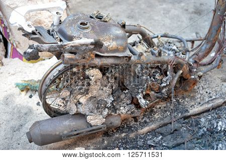 Selective focus of burnt part of motorcycle in riot accident