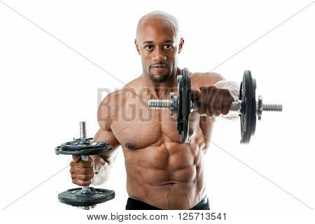 Toned and ripped lean muscle fitness man lifting weights isolated over a white background. Shallow depth of field.