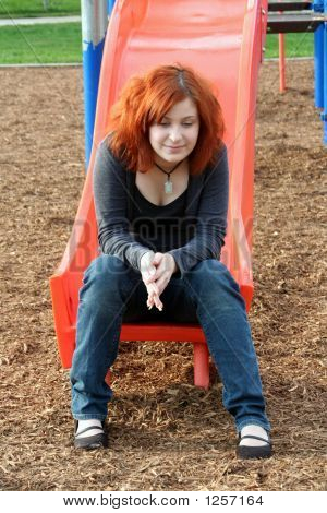 Teen Reminiscing At Playground Vertical