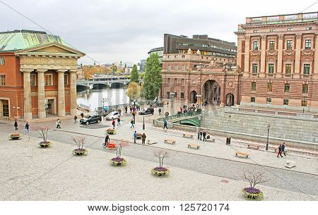 STOCKHOLM, SWEDEN - OCTOBER 17, 2013: View of Sweden Riksdag from Stockholm palace and yard in front of Stockholm palace in Stockholm, Sweden. The Riksdag building is the seat of the Swedish Parliament
