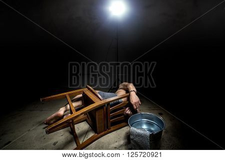 Prisoner being punished with cruel interrogation technique of waterboarding
