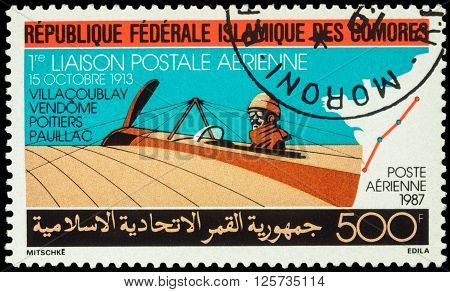 MOSCOW RUSSIA - APRIL 11 2016: A stamp printed in Comoros shows old airplane Morane Saulnier Type H devoted to the 1st Airmail Flight between Villacoublay and Pauillac in 1913 series