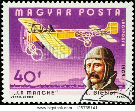 MOSCOW RUSSIA - APRIL 12 2016: A stamp printed in Hungary shows French aviator Louis Bleriot and his plane over the Strait of La Manche series