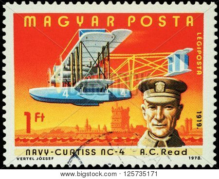 MOSCOW RUSSIA - APRIL 12 2016: A stamp printed in Hungary shows American pilot Albert Cushing Read with flying boat Navy-Curtiss NC-4 series