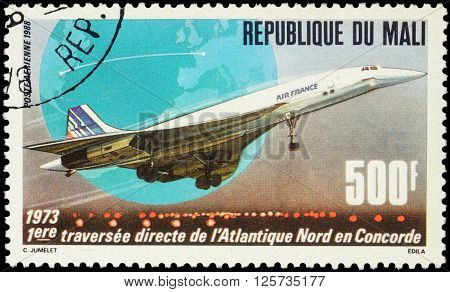 MOSCOW RUSSIA - APRIL 12 2016: A stamp printed in Mali shows supersonic passenger aircraft Concorde devoted to the 15th Anniversary of First North Atlantic Crossing by Concorde circa 1988