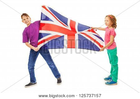 Two happy kids, boy and girl smiling and waving English flag, isolated on white