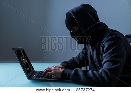 Hacker Stealing Information From Laptop