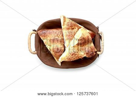 Slice pita bread in a basket on a white background.