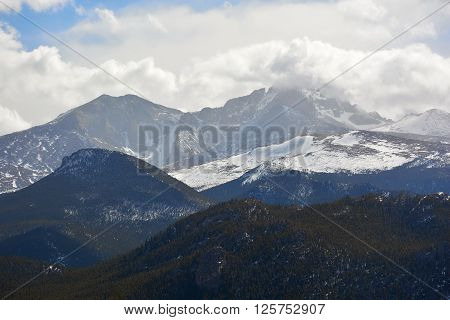 Snow Covered Mountains with Billowing White Clouds