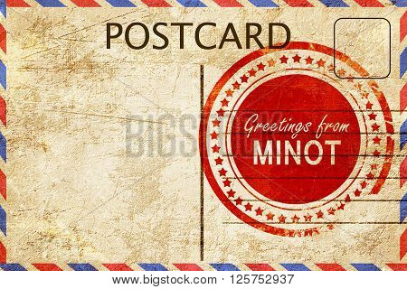 greetings from minot, stamped on a postcard