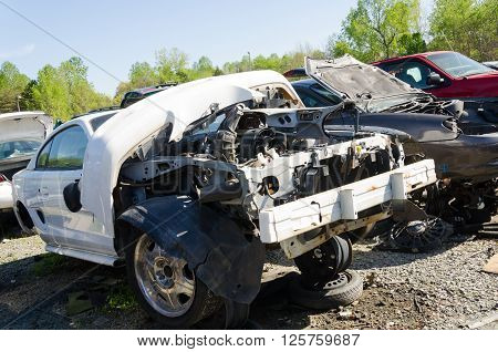 Charlotte, NC, United States - April 14, 2016: Damaged car close up on a junk yard