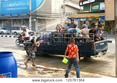 CHIANGMAI THAILAND - APRIL 15 2012 : People in a Songkran water fight festival. Songkran is a joyful summer festival which everybody can splash water to them for cool down from hot weather.