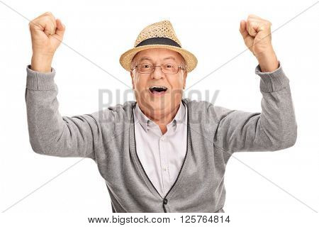 Overjoyed mature man gesturing happiness and looking at the camera isolated on white background