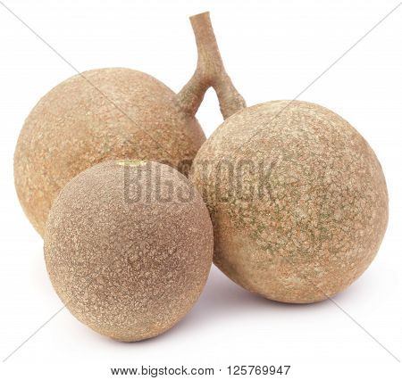 Three wood apples or kod bel of Southeast Asia over white background