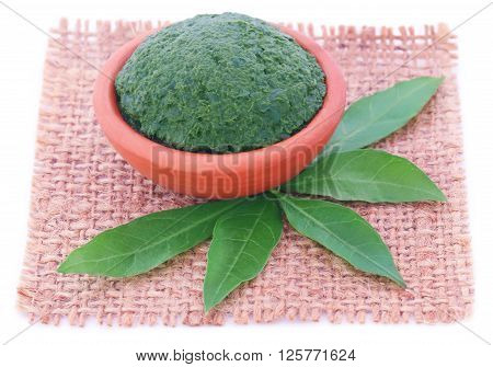 Mashed vitex Negundo or Medicinal Nishinda leaves with paste in a pottery