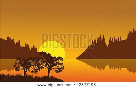 Silhouette of city and lake with moonlight