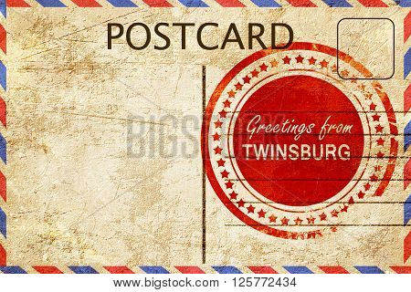 greetings from twinsburg, stamped on a postcard