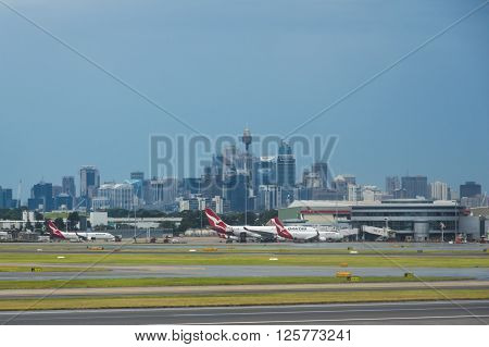 Sydney Australia 18 March 2016  Airplanes on the tarmac at Sydney Airport with the Sydney CBD in background