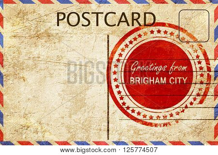 greetings from brigham city, stamped on a postcard