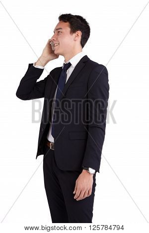 A young caucasian male businessman looking happy holding a mobile phone looking away from camera.
