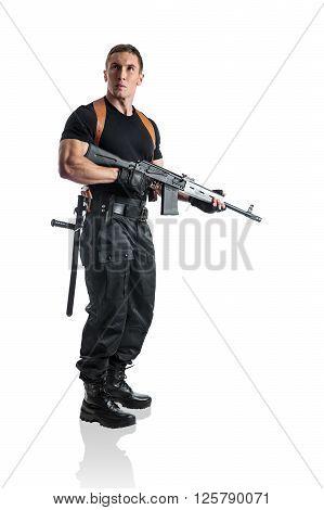 Police officer is holding Kalashnikov. Isolated on white.