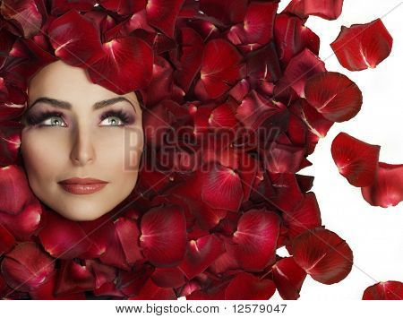 Beautiful Woman's Face and rose petals.Perfect Skin