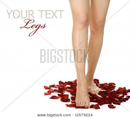 Spa Legs and Rose Petals.Isolated on white