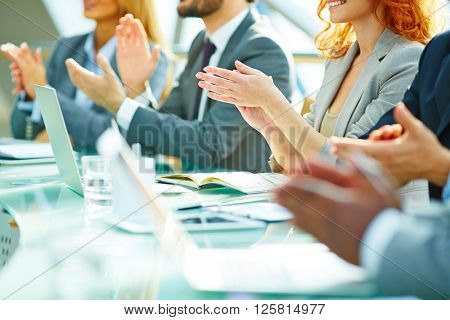 Business people clapping at conference