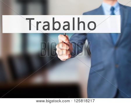Trabalho (work In Portuguese) - Businessman Hand Holding Sign