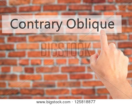 Contrary - Oblique  - Hand Pressing A Button On Blurred Background Concept On Visual Screen.