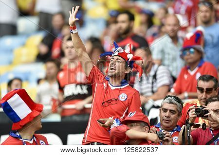 RIO DE JANEIRO BRAZIL - June 18 2014: Fan with happy face during the FIFA 2014 World Cup. Spain is facing Chile in the Group B at Maracana Stadium