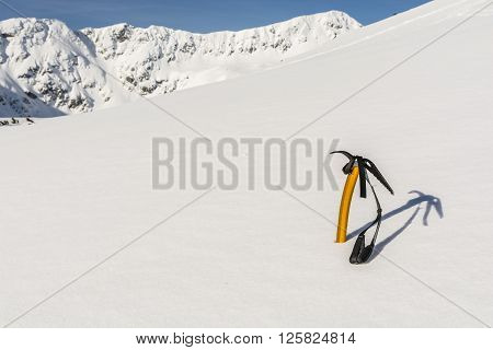 Yellow Ice Axe On The Slopes.
