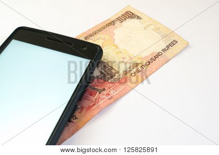 Mobile phone with indian currency set on a white background. Denoting payment through mobile and mobile wallets poster