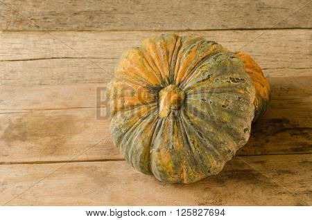 Still life with pumpkins on wooden table background