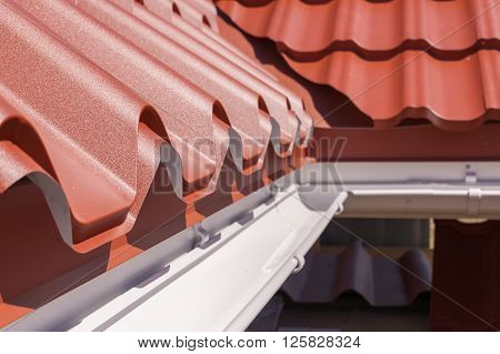 New red metal tile with white rain gutter poster