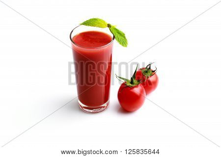 Tomato juice made with organic tomatoes on white background