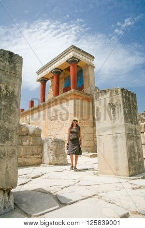 woman traveler tourist walking in landmark monument minoan Knossos palace ruins from 2000 year Before Christ one of the most important greek monuments in Crete Greece Europe