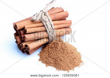 With tied Cinnamon sticks on a white background.