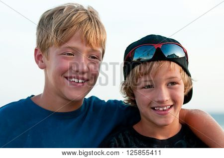 Close up of two adorable brothers outdoors.
