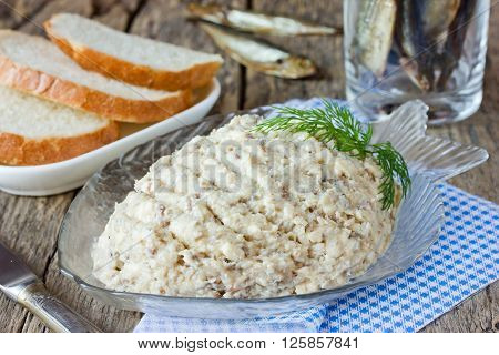 Forshmak paste from herring with butter on old wooden table traditional Jewish cuisine selective focus