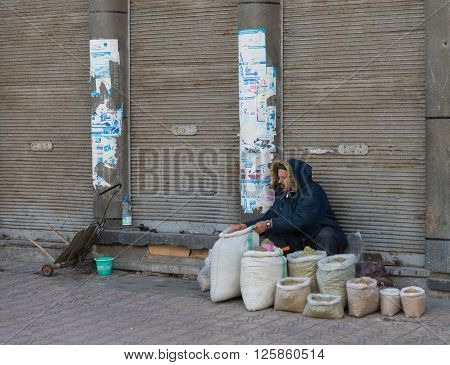 Casablanca Morocco - March 21 2014: The merchant prepares herb bags for sell on March 21 2014 in Casablanca Morocco