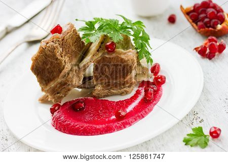 Dish to raise hemoglobin beef boiled with beetroot and pomegranate juice sauce selective focus