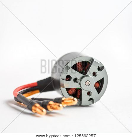Micro DC powered electric motor for model of aircraft of ship on white background