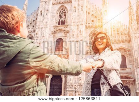 Mother wit son take for hands on the squere near Duomo di Milano