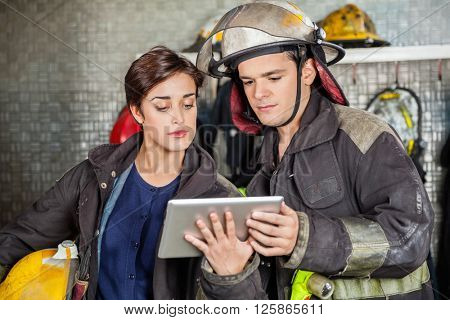 Firefighters Using Digital Tablet