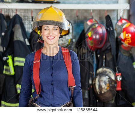 Confident Firewoman Standing At Fire Station